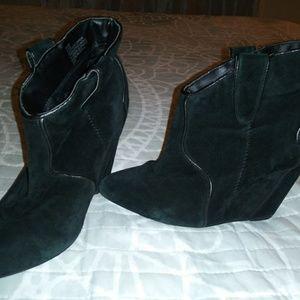 Suede black wedge booties.